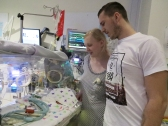 mum and dad bedside bonding NICU baby silver rose
