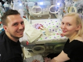 mum and dad bedside NICU baby silver rose